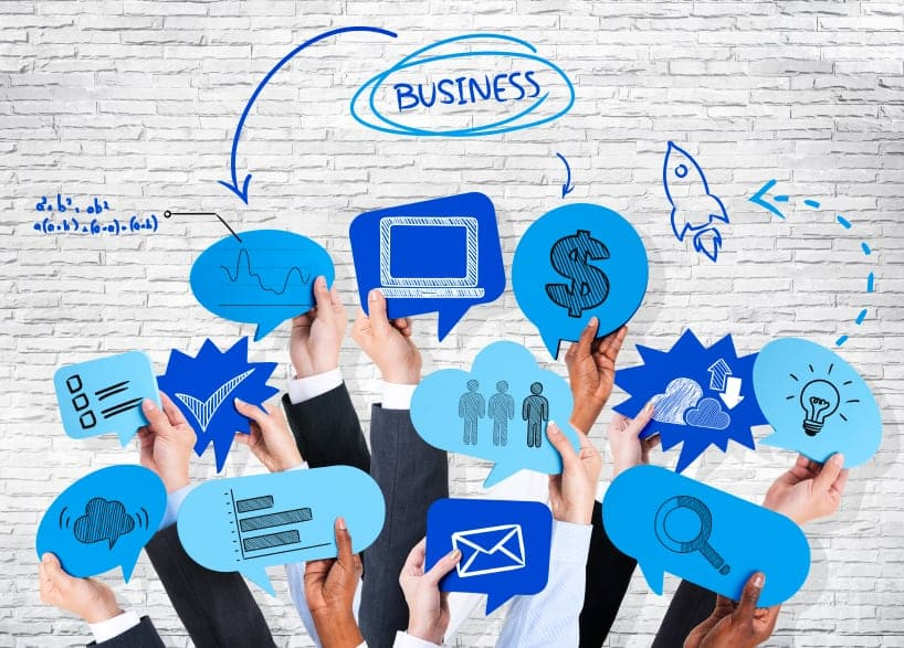 Business people's hands holding speech bubble with business theme