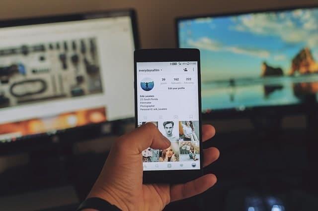 man using instagram on mobile