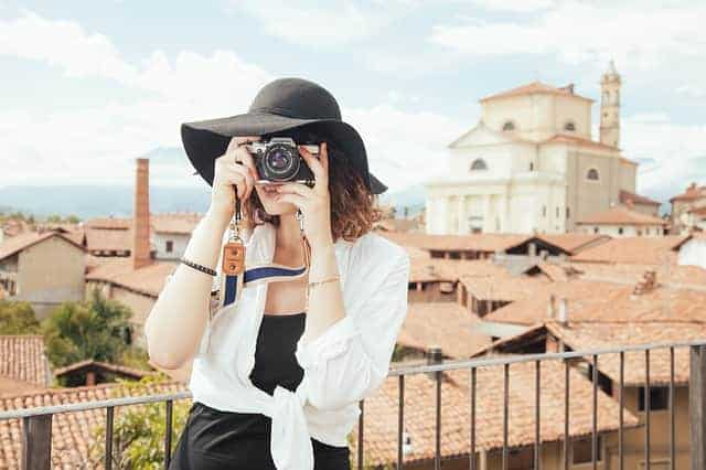 woman taking photo while traveling