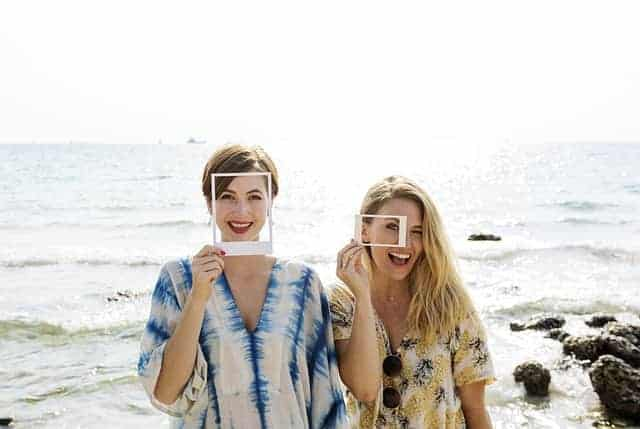women laughing on beach
