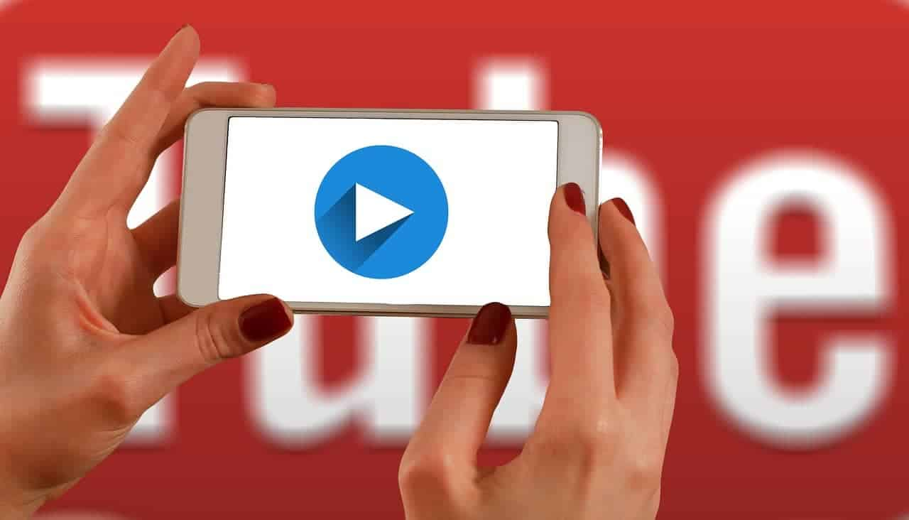 person-on-youtube-on-smartphone