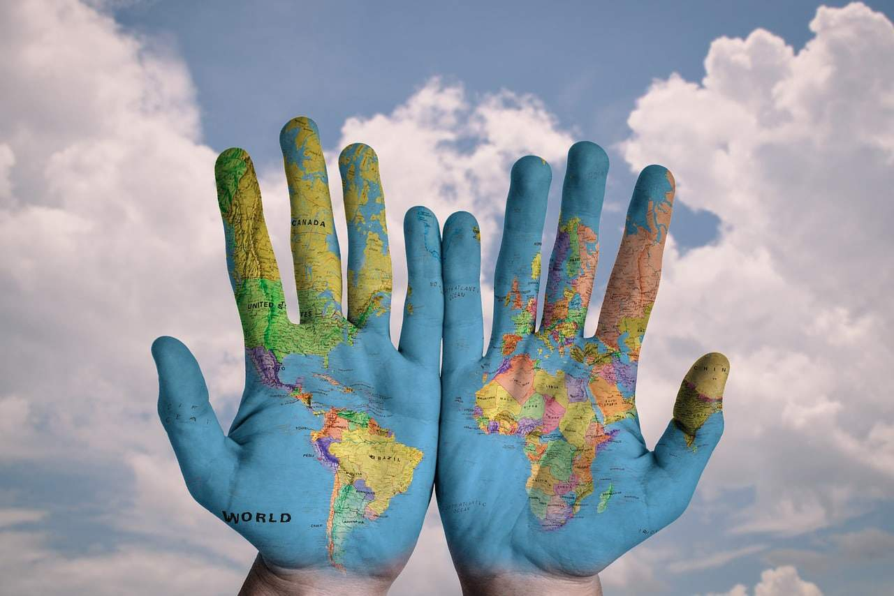world-map-on-hands