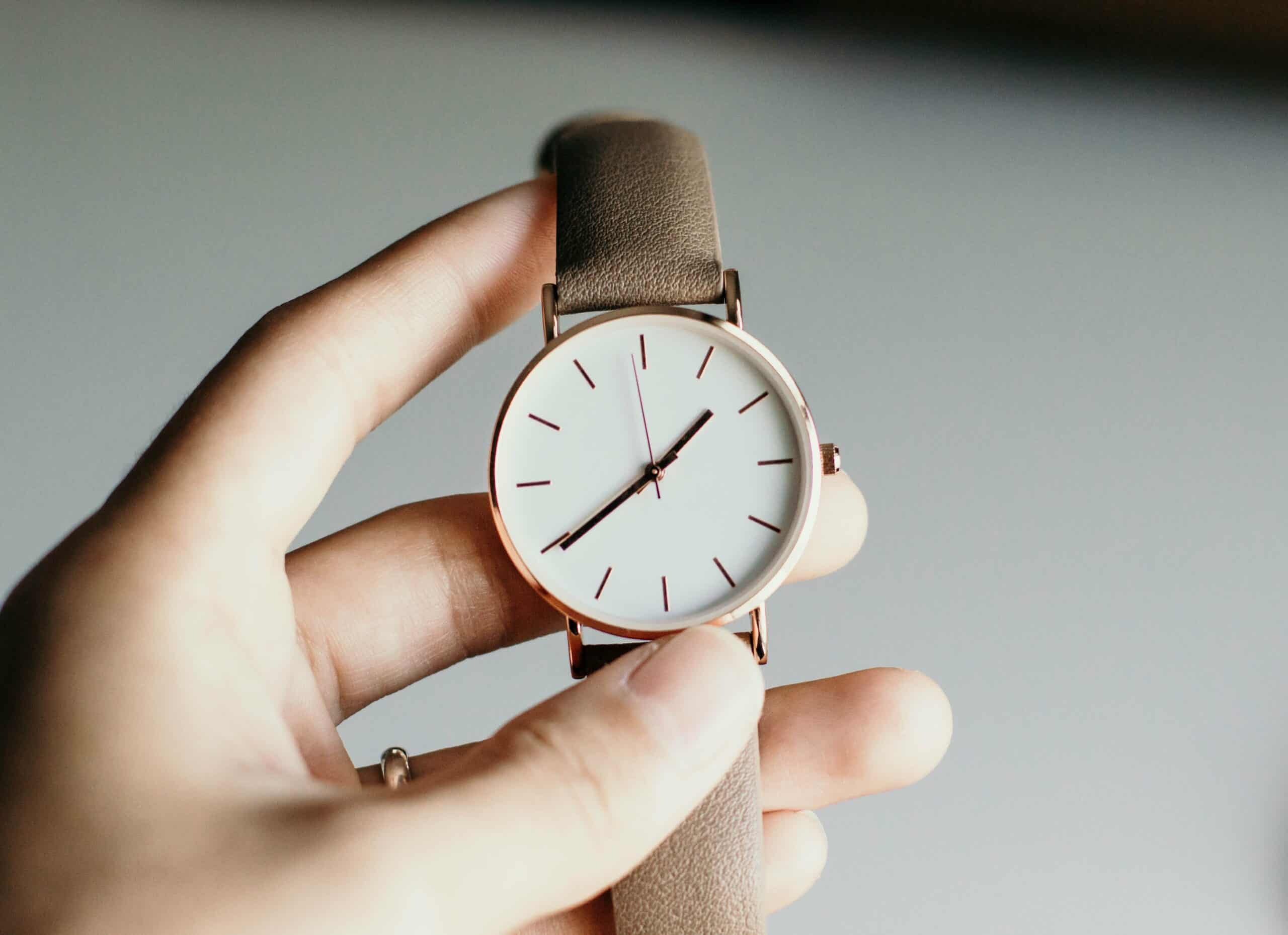 person-holding-watch