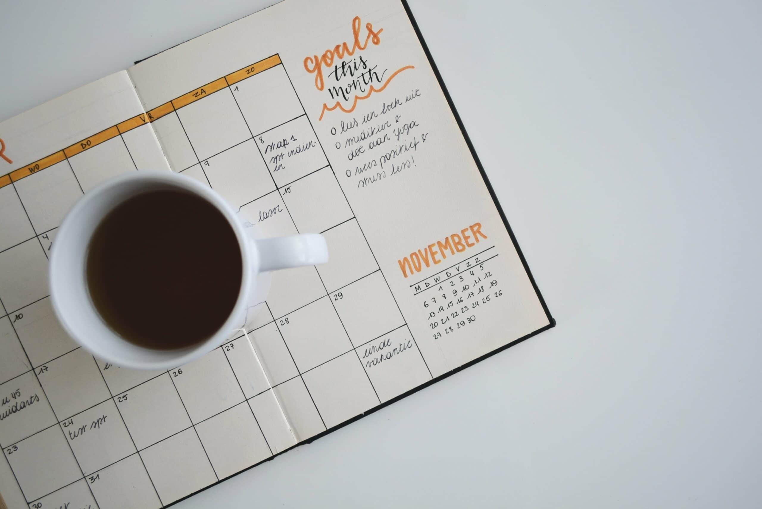 calendar under coffee mug