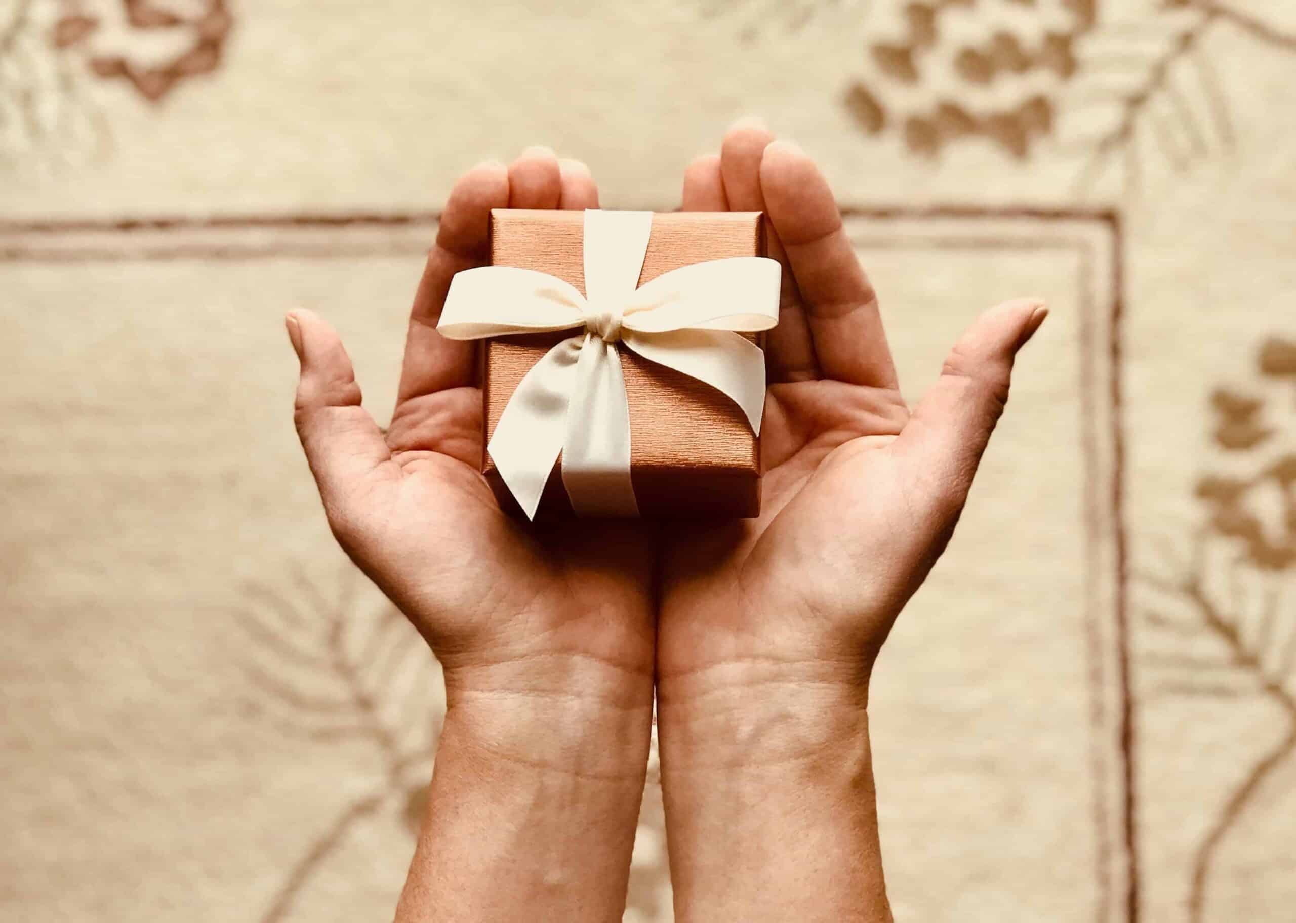 person-holding-gift-box