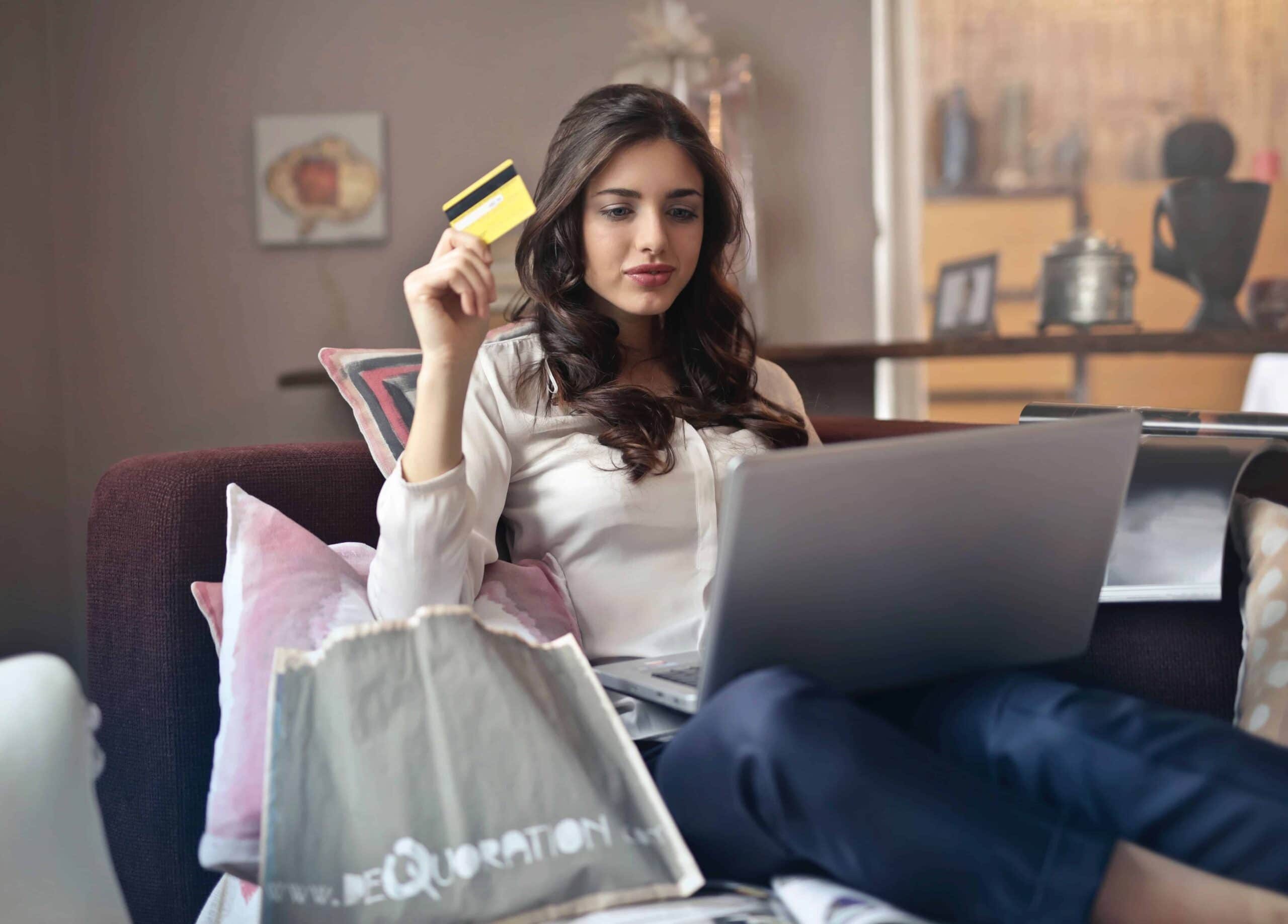 woman-online-shopping-holding-credit-card