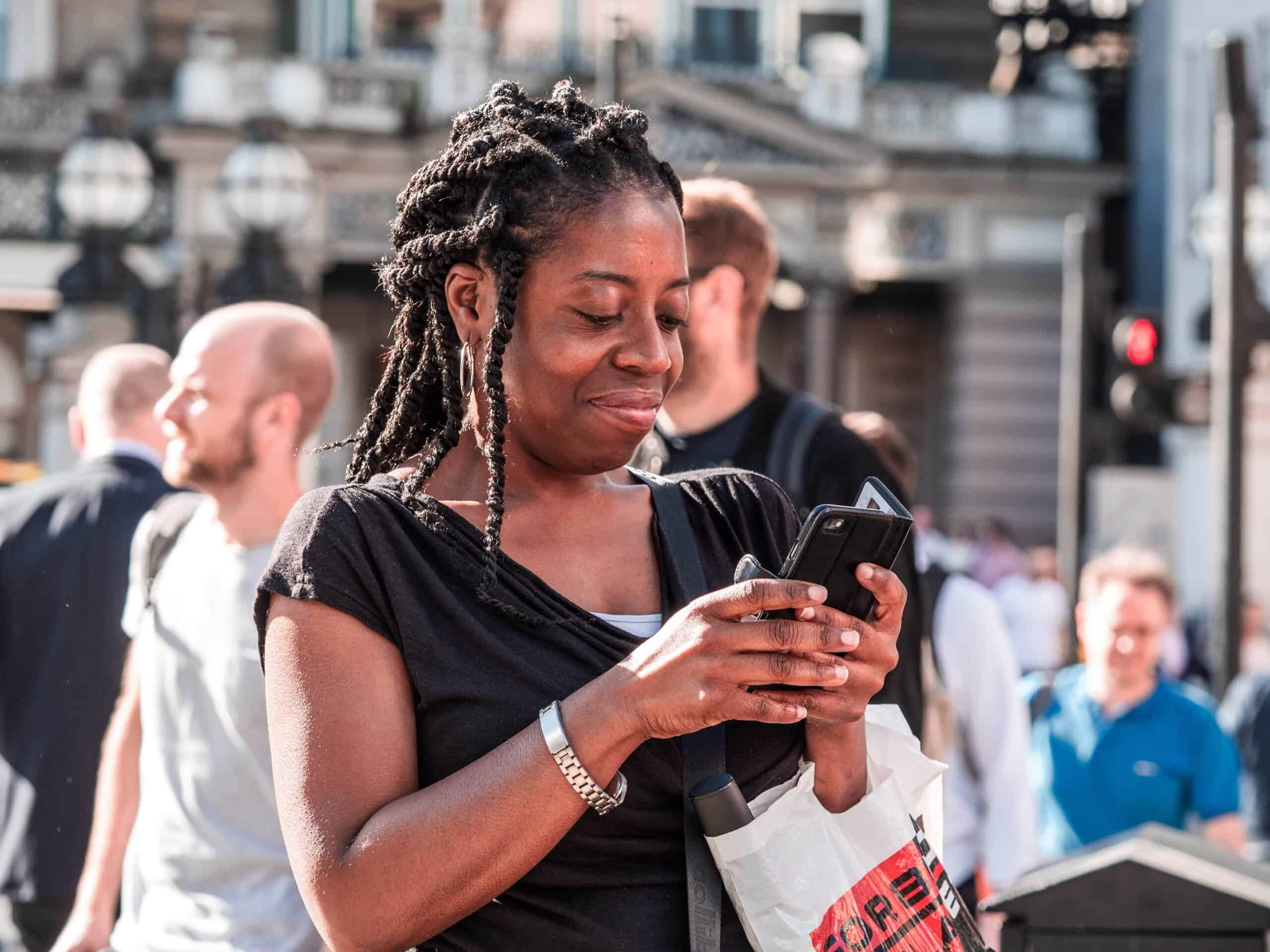 person of color using smartphone