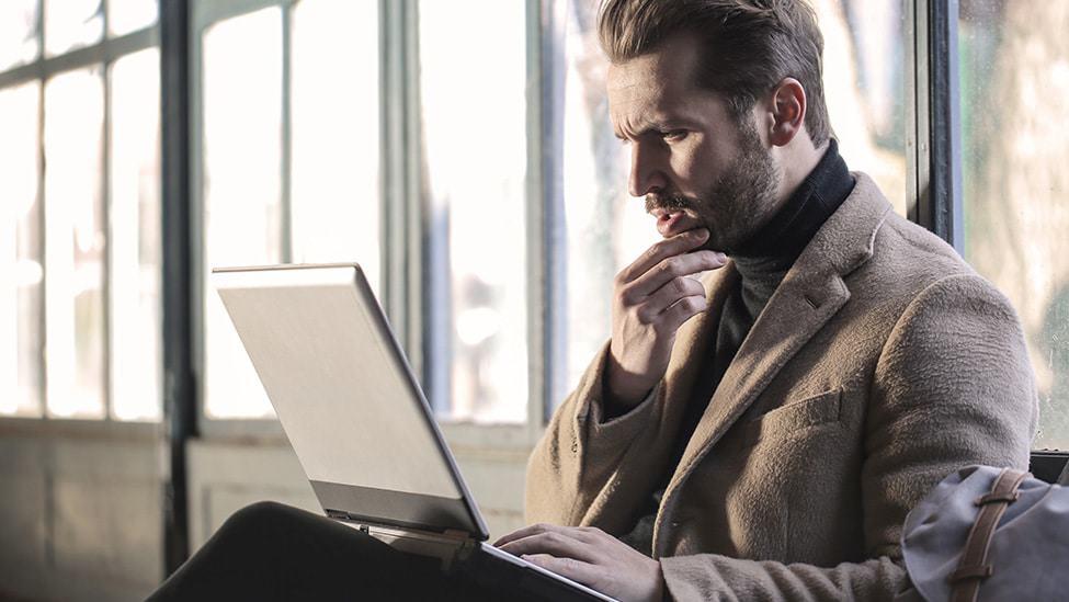 man-typing-on-computer