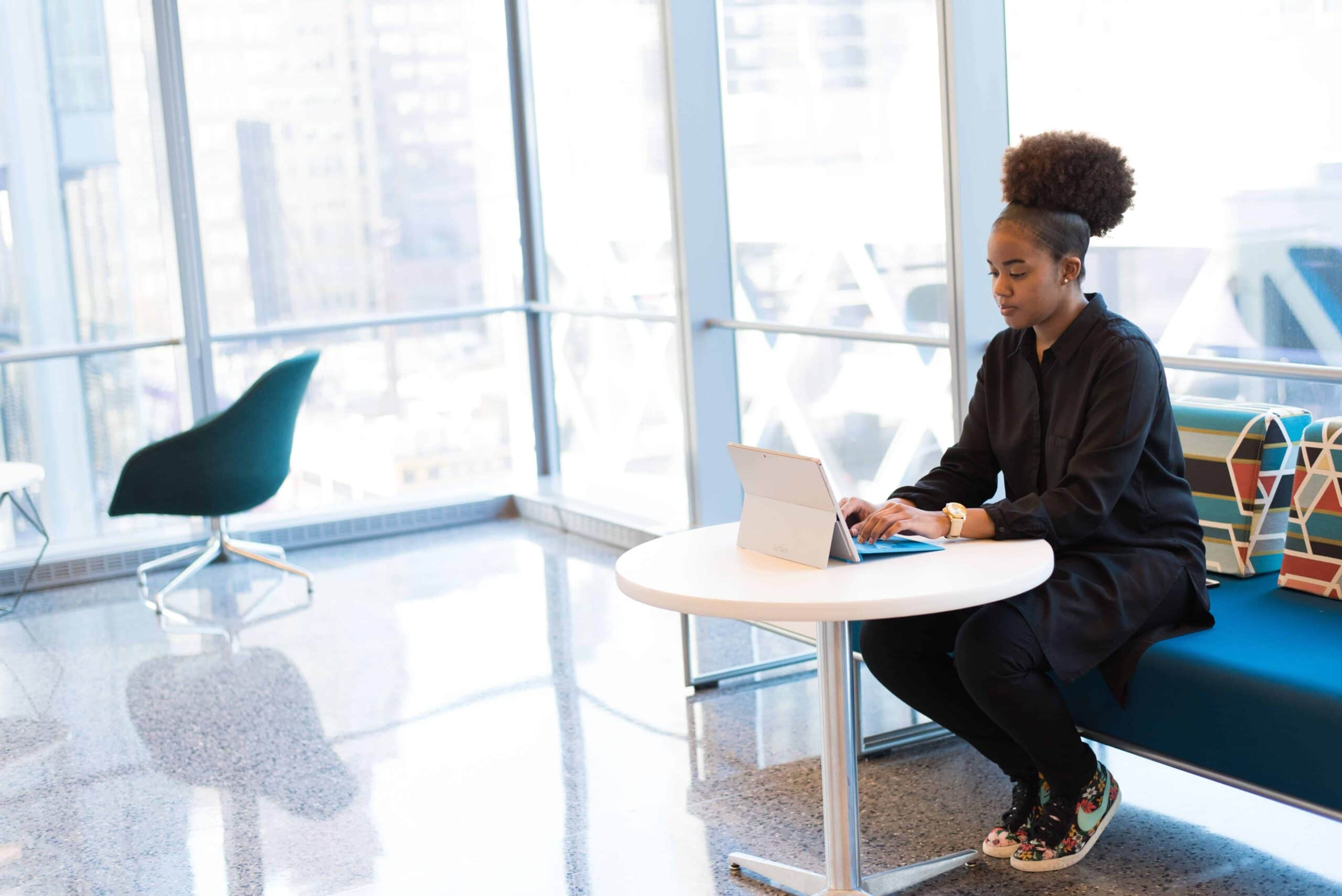 woman-typing-on-ipad