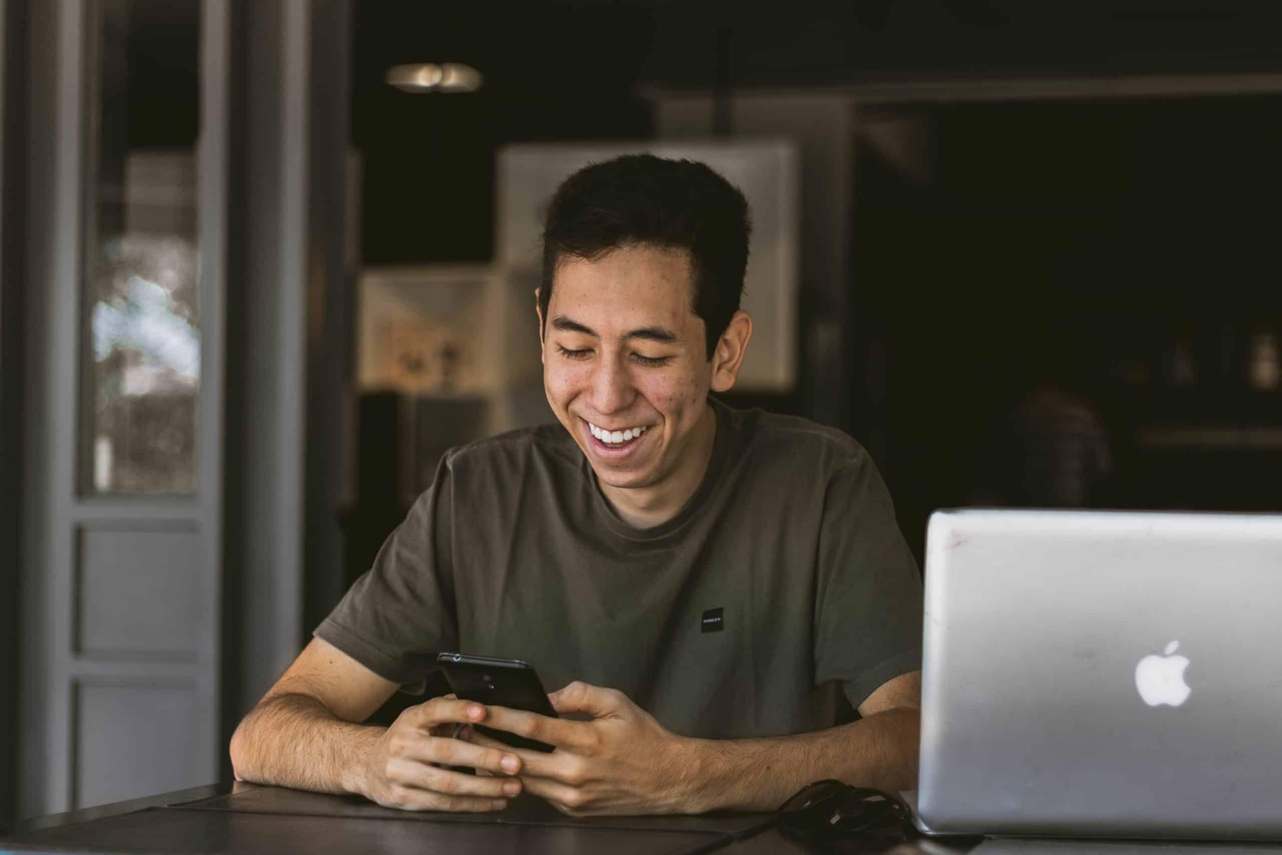 man-on-phone-smiling