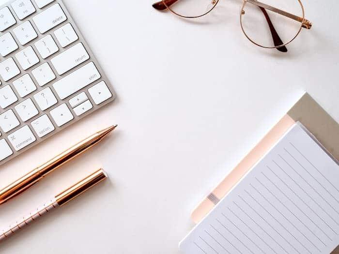 notebook, pen, paper, glasses