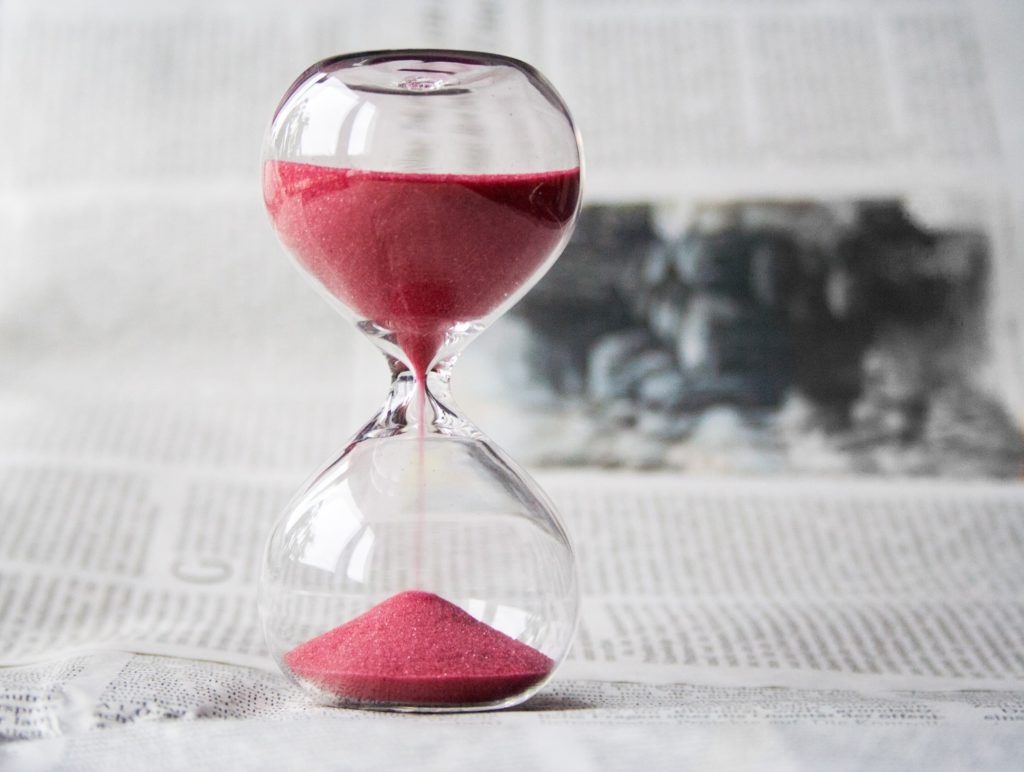 glass timer with red sand