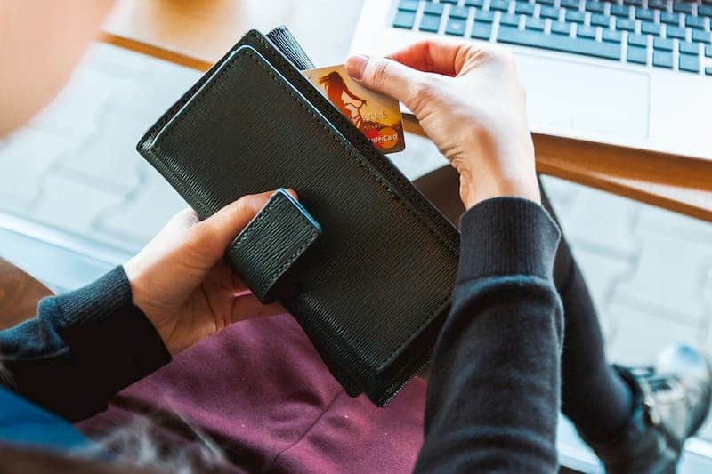 woman getting credit card out of wallet