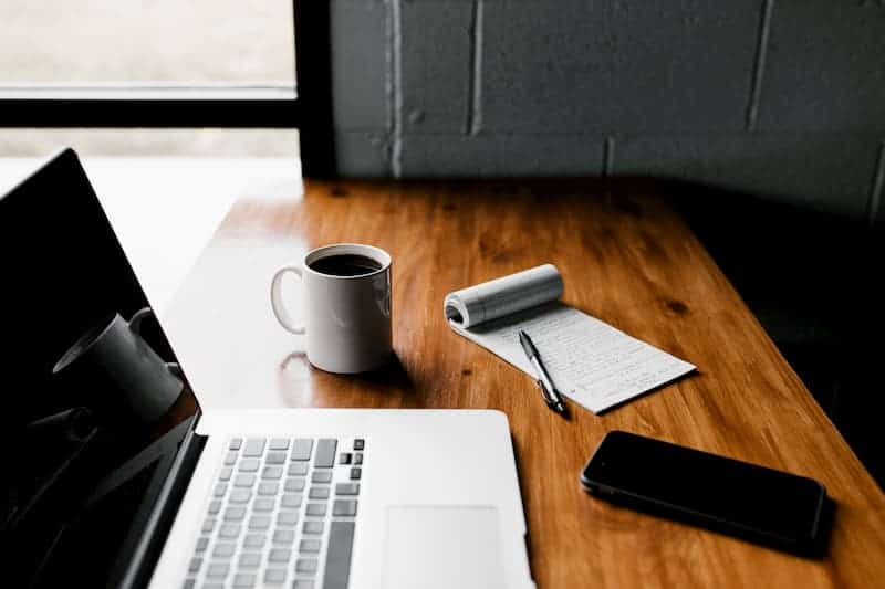 laptop, notebook, mug, phone