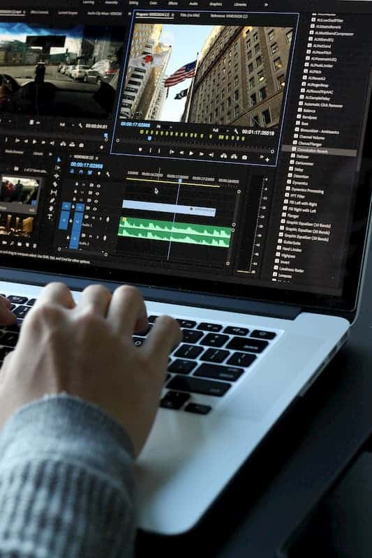 person doing video editing on computer