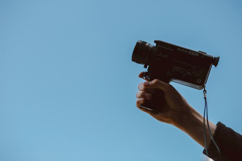 person holding camcorder