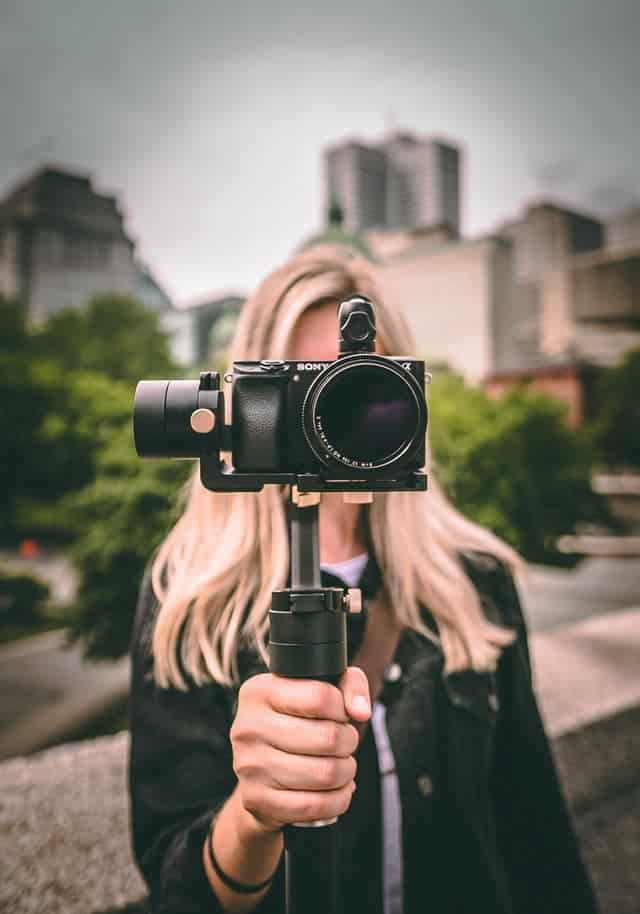 woman holding camera on mount