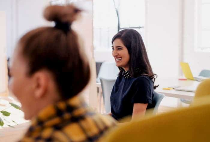 young woman laughing at a social media marketing agency