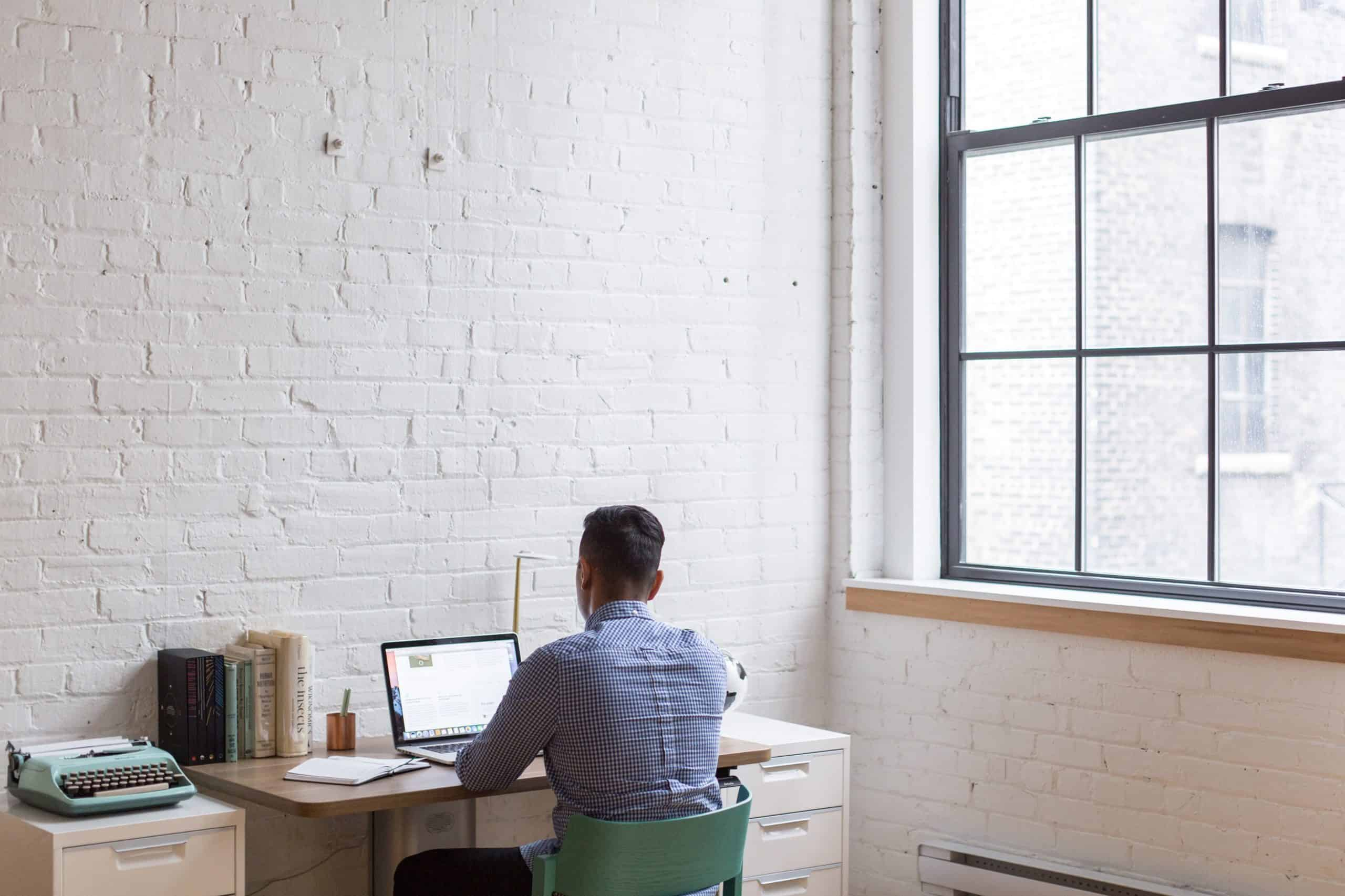 man-working-on-computer-at-desk