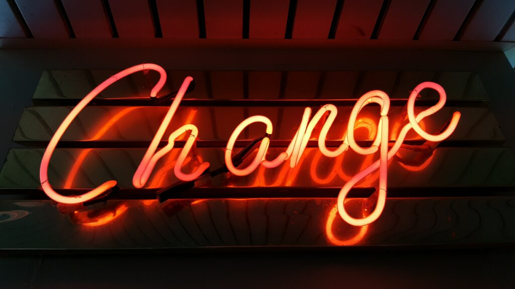 change neon sign unsplash